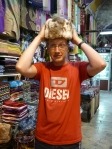 trying on a rabbit hat in the grand bazaar