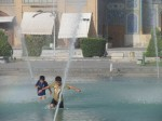 Children playing in the fountains in Esfahan.