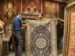 Ian contemplates buying a rug in Tehran, while we look on. A great experience.