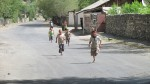 Kids running towards us as we enter their village, wanting their photo taken and a high-five
