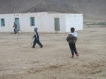 Kids playing the local version of hoopla in Bulunkul
