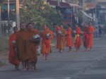More monks taking part in the alms giving ceremony