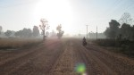 Early morning cycling on dirt road outside of Savannhaket.